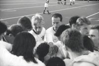The Augsburg men's soccer team get in a huddle, 1993.