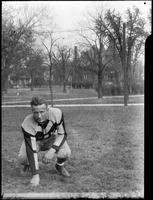 An Augsburg football player posing in Murphy Square, 1926