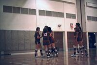 Augsburg women's volleyball team huddle, November 1974