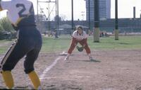 Rival women's softball team player hitting, circa 1976