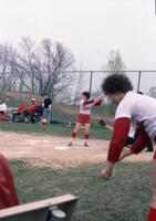 An Augsburg women's softball team player preparing to hit, April 1976