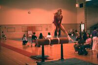 An Augsburg women's gymnastics team member jumps a hurdle , February 1975