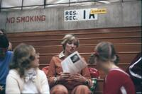 An Augsburg women's gymnastics team member conversing with an audience member, February 1976
