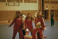 Augsburg women's gymnastics team members posing with roses, February 1975