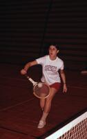 Close up of an Augsburg women's tennis team player returning a ball, April 1975