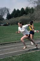 Action shot of An Augsburg women's track and field team runner, April 1976