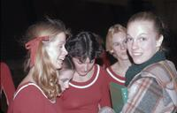 Augsburg women's gymnastics team conversing, February 1977