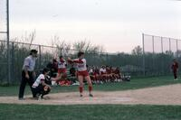 An Augsburg women's softball team player hitting at home base, April 1976