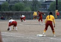 Augsburg women's softball team pitching, circa 1976