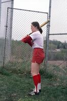 An Augsburg women's softball team player in a batting cage, April 1976