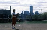 An Augsburg women's softball team player in team uniform on the field, circa 1976