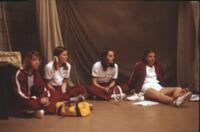 Augsburg women's gymnastics team members taking a break, April 1976