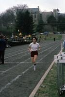 Augsburg women's track and field team runner running, April 1976