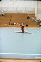 An Augsburg women's gymnastics team member doing the splits on a mat, February 1977