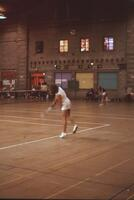 Two simultaneous tennis matches, April 1976