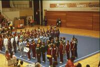 Gymnastics teams standing in a line, February 1976