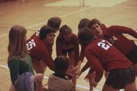 Augsburg women's volleyball team doing a team hand stack, November 1976