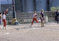 An Augsburg women's softball team player running to a base, circa 1976