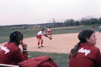 Augsburg Women's softball team players standing mid-to outfield in ready positions, April 1976