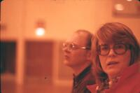 Close up of two people at an Augsburg Women's basketball game, February 1976