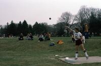 An Augsburg Women's Track and Field and field player throwing a ball, April 1976