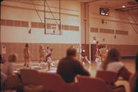 Three-point basketball shot during an Augsburg women's basketball team game, February 1976