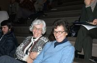Two women in the bleachers smiling for a photo, February 1977