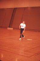 An Augsburg women's softball team player on base looking out, April 1975