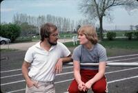 Augsburg Women's Track and Field coach and player conversing, April 1977