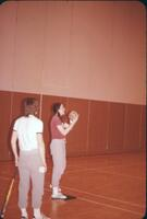 Augsburg women's softball team practicing, April 1975