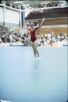 An Augsburg women's gymnastics team member doing a straight stand , February 1977