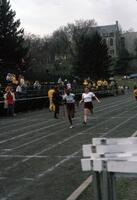 Augsburg women's track and field team runner sprinting, April 1976