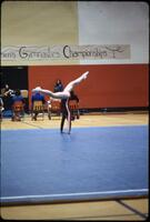An Augsburg women's gymnastics team member performing a handstand, March 1978