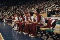 Augsburg women's basketball team sitting on the sidelines, circa 1979
