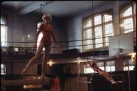 Women's gymnastics team practicing with equipment, February 1978