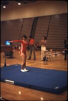 An Augsburg women's gymnastics team member standing on a mat, March 1979