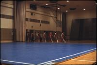 Augsburg women's gymnastics team practicing marching in a line for the MAIAW competition