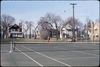 An Augsburg women's tennis team player hitting the ball back, April 1978