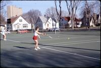 Augsburg women's tennis team practicing returning the ball, April 1978