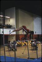 An Augsburg women's gymnastics team member flipping over a low bar, March 1978
