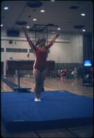 "An Augsburg women's gymnastics team member standing on a mat doing a ""Ta-Da"", March 1979"