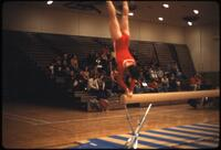 An Augsburg women's gymnastics team member doing a handstand, March 1979