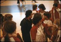 Augsburg women's basketball team conversing in a group, February 1978