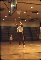 "An Augsburg women's basketball team player ""Bobby Jo"" practicing a layup, March 1979"