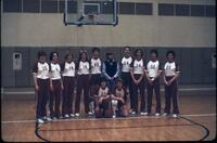 Women's basketball posing for a team photo, March 1979