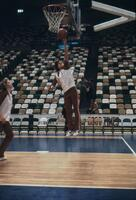 An Augsburg women's basketball team player jumping to do a layup, circa 1978
