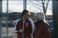 An Augsburg women's tennis team player laughing with someone, April 1978