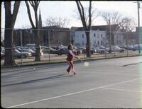 An Augsburg women's tennis team player missing the ball, April 1978