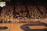 Augsburg women's basketball team lined up in a stadium, circa 1978