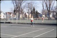 An Augsburg women's tennis team player backhanding the ball, April 1978
